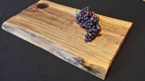 Stunning Walnut Carving Board with Live Edge. Suggested retail $85.00